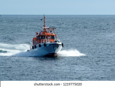Special service orange boat sailing very fast through the sea to the rescue.