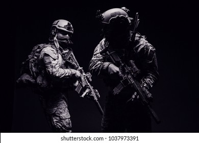 Special soldiers or private military contractors holding rifle. Image on a black background. war, army, weapon, technology and people concept