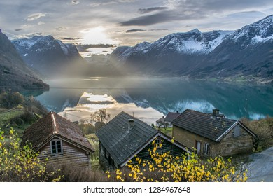 Special sunlight over a small village . Photo from Flo in Oppstryn , in Norway .
