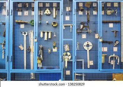 Special tools for car repairs are beyond blue lattice in closet.