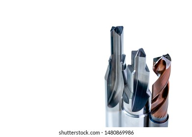 Special tools isolated on white background. Made to order special tools. Coated step drill and reamer detail. HSS cemented carbide. Carbide cutting tool for industrial applications. Engineering tools.