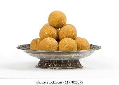 """Special Traditional indian sweet food """"Besan Laddu"""" made of gram flour, dry fruits, coconuts and other spices"""