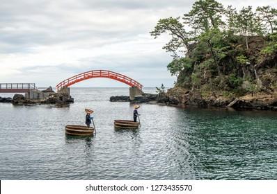 Special tub-boats sailing in a bay at Sado, Japan