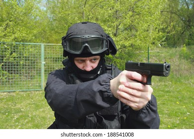 Special unit policeman with a gun