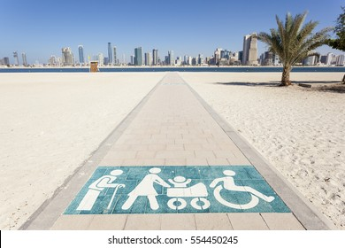 Special walkway for disabled, elderly and mothers with a baby stroller at the Al Mamzar beach in Dubai, United Arab Emirates