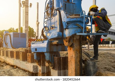 Specialist contorling hydraulic vibratory hammer driven machine pressing retaining wall steel sheet pile for protection sliding of soil under the construction site project
