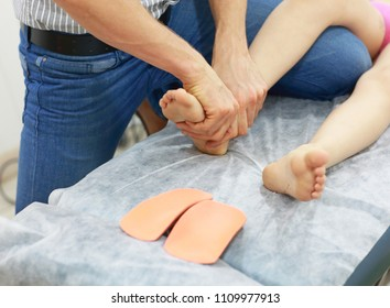 specialist dealing with flat feet problem   with orthopedic insoles