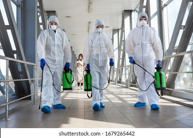 Photo of Specialist in hazmat suits cleaning disinfecting coronavirus cells epidemic, pandemic health risk