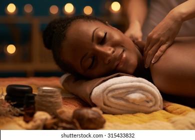 Specialist massaging patients nape of neck