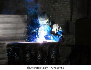 Specialist performing welding in workshop