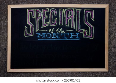 """Specials Of The Month"" Written With Real Chalk On A Black Board"