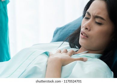 Specialty Doctor diagnostics be unable to breathe Female Patient. Professional Caucasian Doctor and close up of patient Diagnosis while in the hospital. Hospital and Medicine and health care Concept.