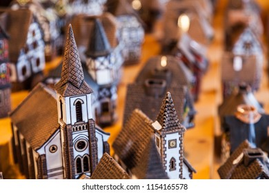 Specific Alsacian miniature ceramic houses on a sovenirs market stand in Alsace, France.