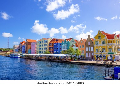 Specific coloured buildings at street in Curacao
