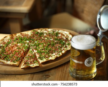 speck and onion pizza with beer