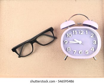 spectacle alarm clock brown background