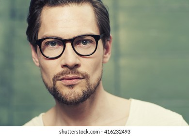 Spectacles on handsome man in studio, portrait