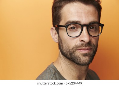 Spectacles on serious man in portrait