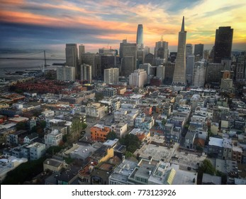 A Spectacular Aerial View of Downtown San Francisco and the Bay Bridge at sunset taken from the top of Coit Tower on Telegraph Hill.