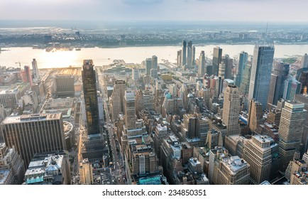Spectacular aerial view of Manhattan. Skyscrapers at dusk.