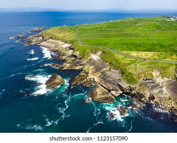 Spectacular aerial view of Mullaghmore Head with huge waves rolling ashore. Picturesque scenery with magnificent Classiebawn Castle. Signature point of the Wild Atlantic Way, County Sligo, Ireland