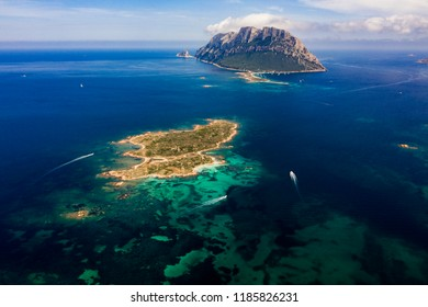 Spectacular aerial view of Tavolara's island bathed by a clear and turquoise sea, Sardinia, Italy.