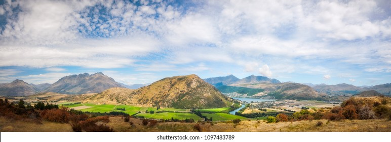 Spectacular alpine Panorama looking to Queenstown from above at the Remarkable Mountain showing Lake Wakatipu, Cecil Peak, Ben Lomond, Queenstown Hill and Kawarau River on a beautiful summer day.