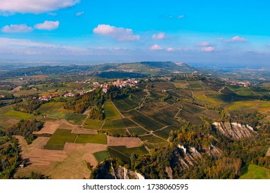 Spectacular autumn aerial view of the Piedmontese Langhe, Unesco heritage, with the vineyards,  with the vineyards that produce the famous wine Barolo. In the center the ancient village of  Novello.