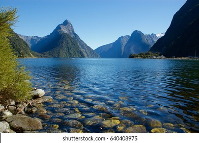 Spectacular and beautiful fjord in the world! Stunning nature with sea and lake in summer time. Mitre Peak reflected in the calm water. NEW ZEALAND, SOUTH ISLAND, MILFORD SOUND - (Piopiotahi in Maori)