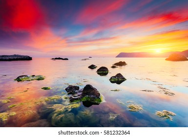 Spectacular Black Sea in the evening light. Picturesque and gorgeous scene. Location place Crimea, Ukraine, Europe. The famous seaside resort of Balaklava. Artistic picture. Beauty world.