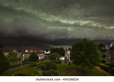 Spectacular cloud front of an upcoming thunderstorm turning day into night. The thunderstorm was one of the worst of the last decade in the west of Germany and caused heavy damage.