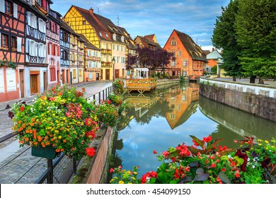 Spectacular colorful traditional french houses on the side of river Lauch in Petite Venise, Colmar, France, Europe