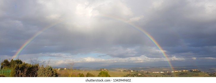 Spectacular complete rainbow over the Chianti hills, south of Florence in Tuscany