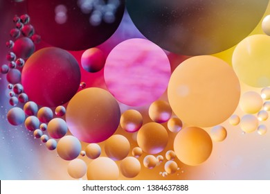 """Spectacular """"Cosmos"""" background in the form of multicolored circles. Made of oil drops. Macro Photo. Space concept, science, atoms, microcosm."""