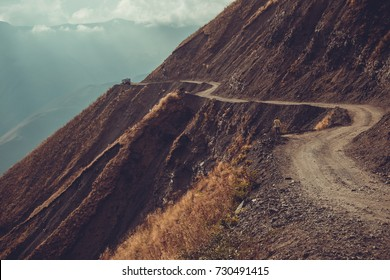 Spectacular and dangerous mountain road, Tusheti, Georgia. Adventure concept. Mount landscape. Unpaved winding road. Dirt serpentine road. Explore the world. Travel to Caucasus. Impressive view.