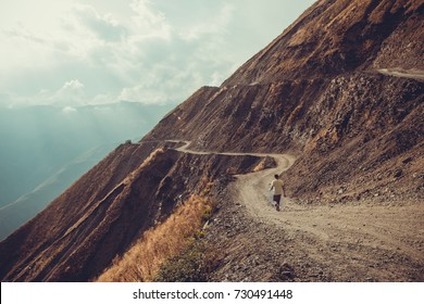 Spectacular and dangerous mountain road, Tusheti, Georgia. Adventure concept. Mount landscape. Unpaved winding road. Dirt serpentine road. Sunlight rays. Explore the world. Travel to Caucasus. Autumn