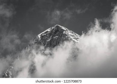 The spectacular Eiger North Face mountain peak, world famous for rock climbing in the alpine region of Kleine Scheidegg in Grindelwald, Switzerland.