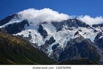 spectacular glaciated mountain peaks on a sunny day in summer near mount cook village on the south island of new zealand