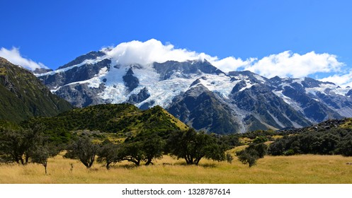 spectacular glaciated mountain peaks on a sunny day in summer on the hooker valley track near mount cook village on the south island of new zealand