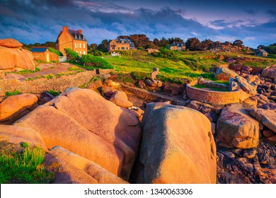 Spectacular holiday villas with colorful granite rocks at sunset, Perros Guirec, Brittany (Bretagne) region, France, Europe