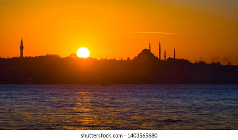 Spectacular Istanbul silhouette at sunset. Minarets silhouette of Istanbul Suleymaniye Mosque at sundown on the Bosphorus.