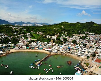 Spectacular journey to the Yung Shue Wan old village, Lamma island, Hong Kong. Photo made by drone. Bird flight.