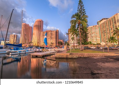 Spectacular landscape of boats and yachts docked at the Ala Wai Harbor the largest yacht harbor of Hawaii and Honolulu skyline at sunset. Oahu, Hawaii, United States.