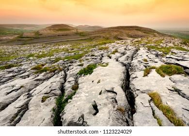 Spectacular landscape of the Burren region of County Clare, Ireland. Exposed karst limestone bedrock at the Burren National Park. Rough Irish nature.