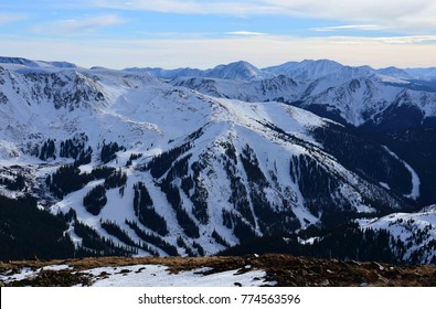 spectacular late afternoon view in the winter of arapahoe basin ski area above the  loveland pass summit, in the rocky mountains of colorado