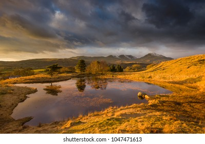 Spectacular light over Kelly Hall Tarn at sunset. A very dramatic sky that was brought to life in the golden hour