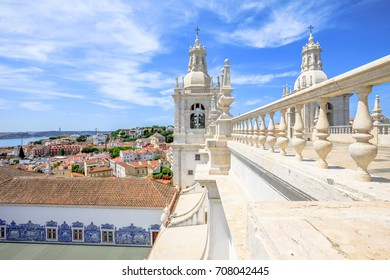 Spectacular lisbon aerial view of 25 April Bridge, Tagus River and colorful Alfama neighborhood from roof top of popular Church or Monastery of Sao Vicente of Fora. Lisbon capital, Portugal, Europe