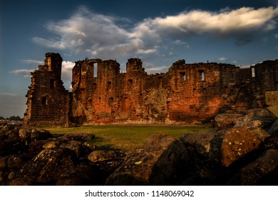 Spectacular moody sunset view of Penrith Castle in Cumbria, United Kingom.