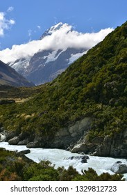 spectacular  mountain cook and the hooker river on a sunny day in summer along the hooker valley track near mount cook village on the south island of new zealand