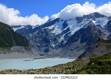 spectacular  mountain  scenery and a glacial lake on a sunny day in summer along the hooker valley track near mount cook village on the south island of new zealand